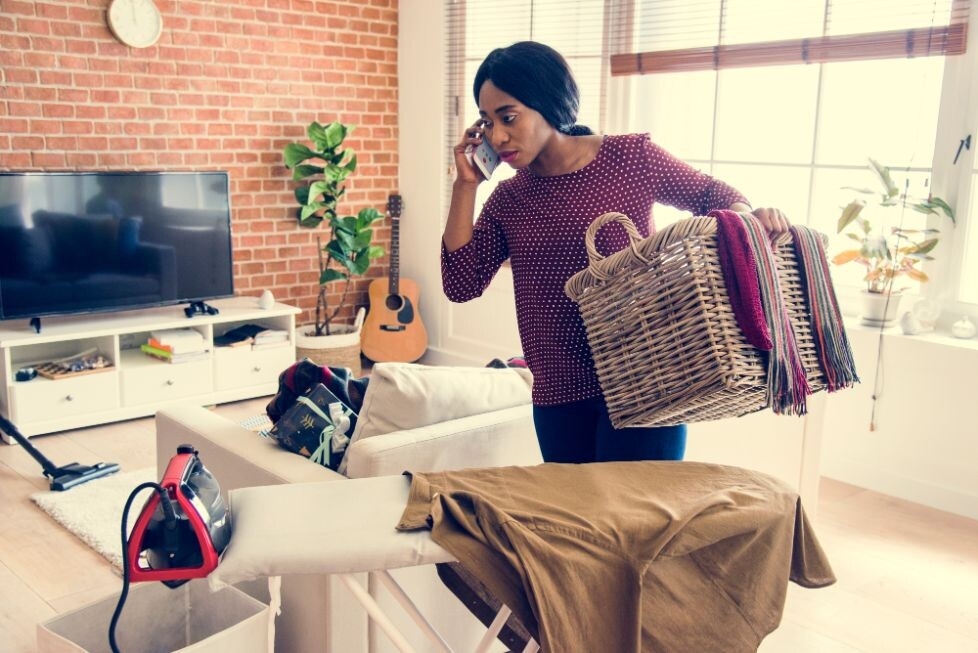 black woman cleaning home housework PCRM