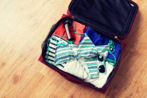 close up of travel bag with beach clothes PBFN