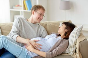 happy pregnant wife with husband at home PFDECY