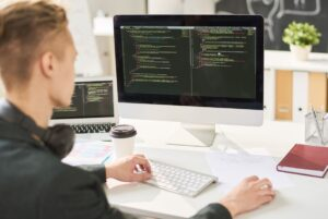 man coding in office LHVWS