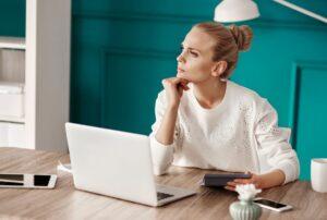 serious woman planning her budget CKJZ