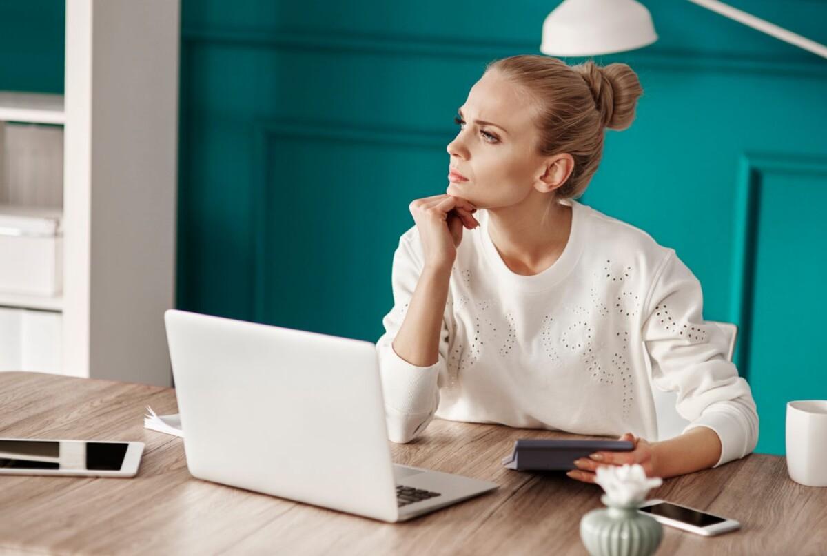 serious-woman-planning-her-budget-25CKJ3Z