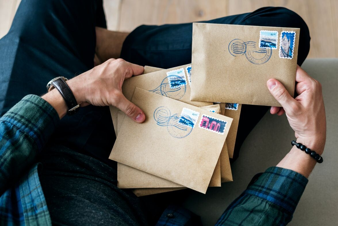 aerial view of a man sorting an envelope pewma