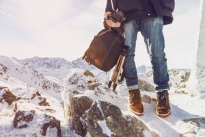 photographer traveler on a mountain top with equip pqz