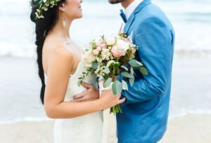 young couple getting married at the beach RSYJ