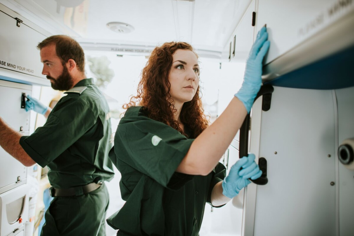 paramedic team checking equipment in an ambulance gpdknt