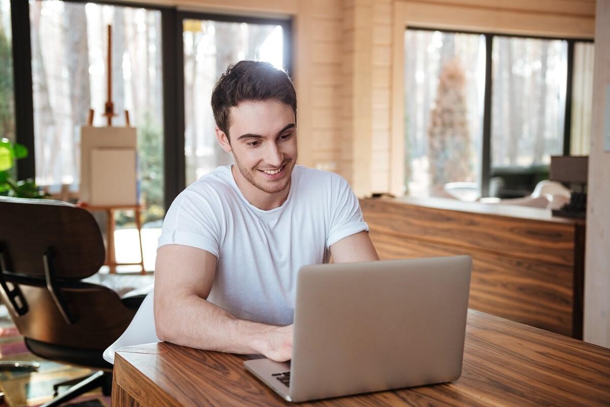 smiling-man-using-laptop