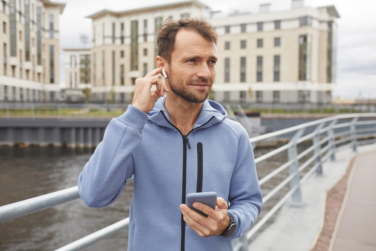man listening to music while running