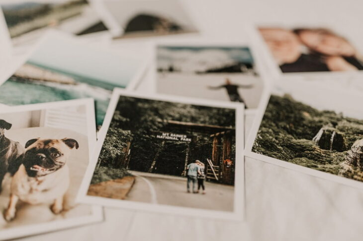 vintage polaroid photos layign on the bed