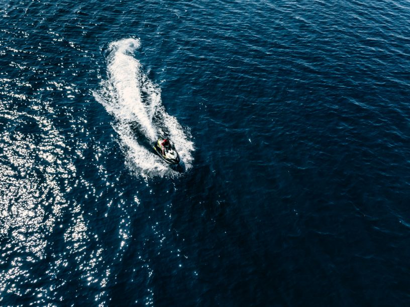 aerial view of jet skier in blue sea jet ski in tu CHSWUT