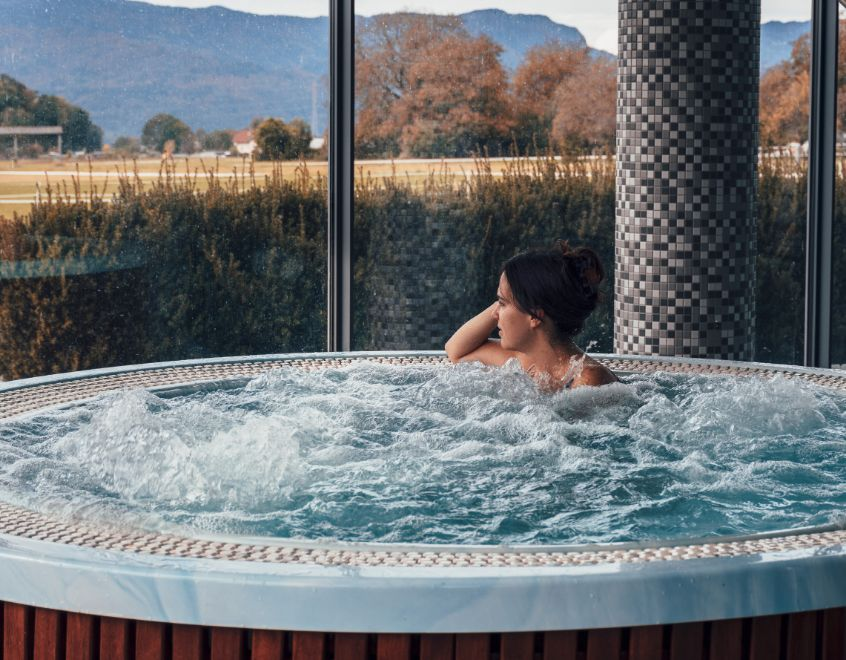 attractive young woman in jacuzzi hot tub spa rela GFXFD