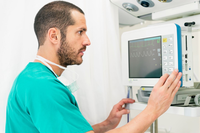 medical doctor making ecg test in hospital UCNE