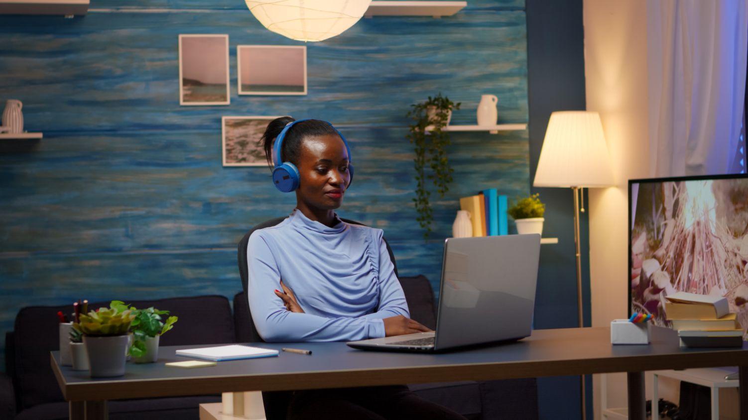 african american with wireless headphones listenin QKHFH