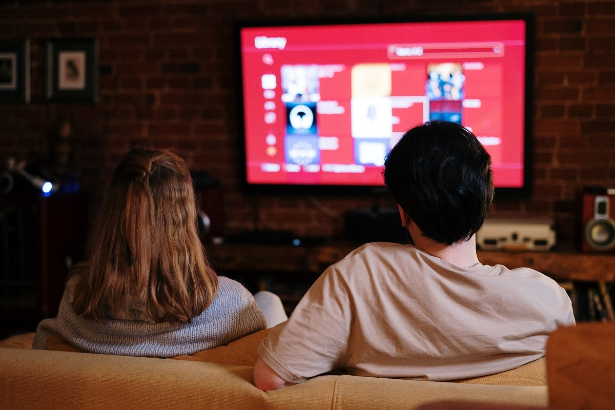 couple watching their tv in living room