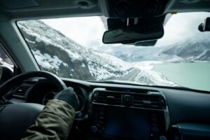 driving off road car on snowing high altitude moun MUSL