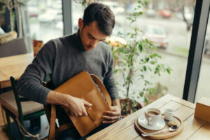 handsome businessman with leather bag