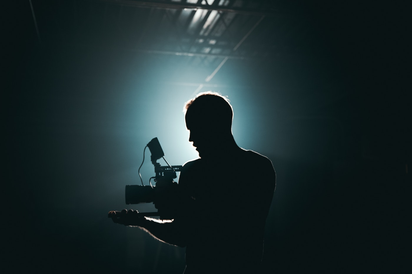 man filming a production video