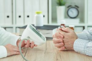 doctor and patient with digital blood pressure mon HRA