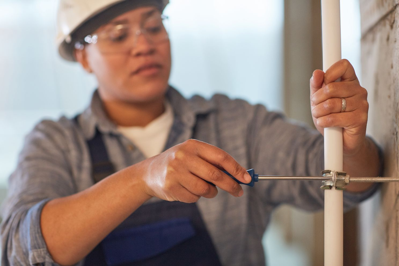 female plumber working UFP