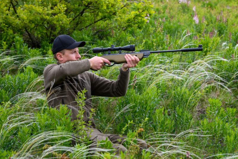 male with a gun in hunting period CFUPYMY