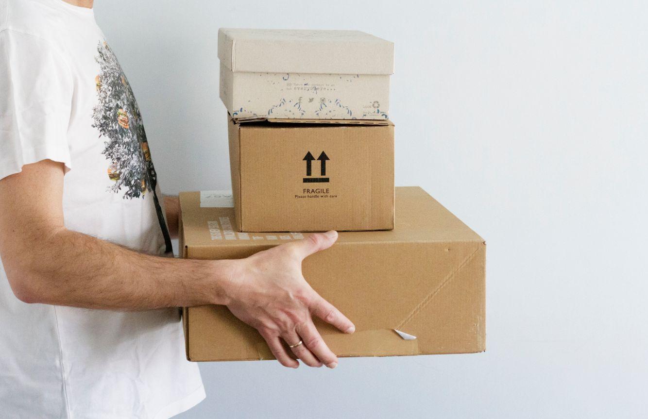 man holding packages for delivering ECEHLP