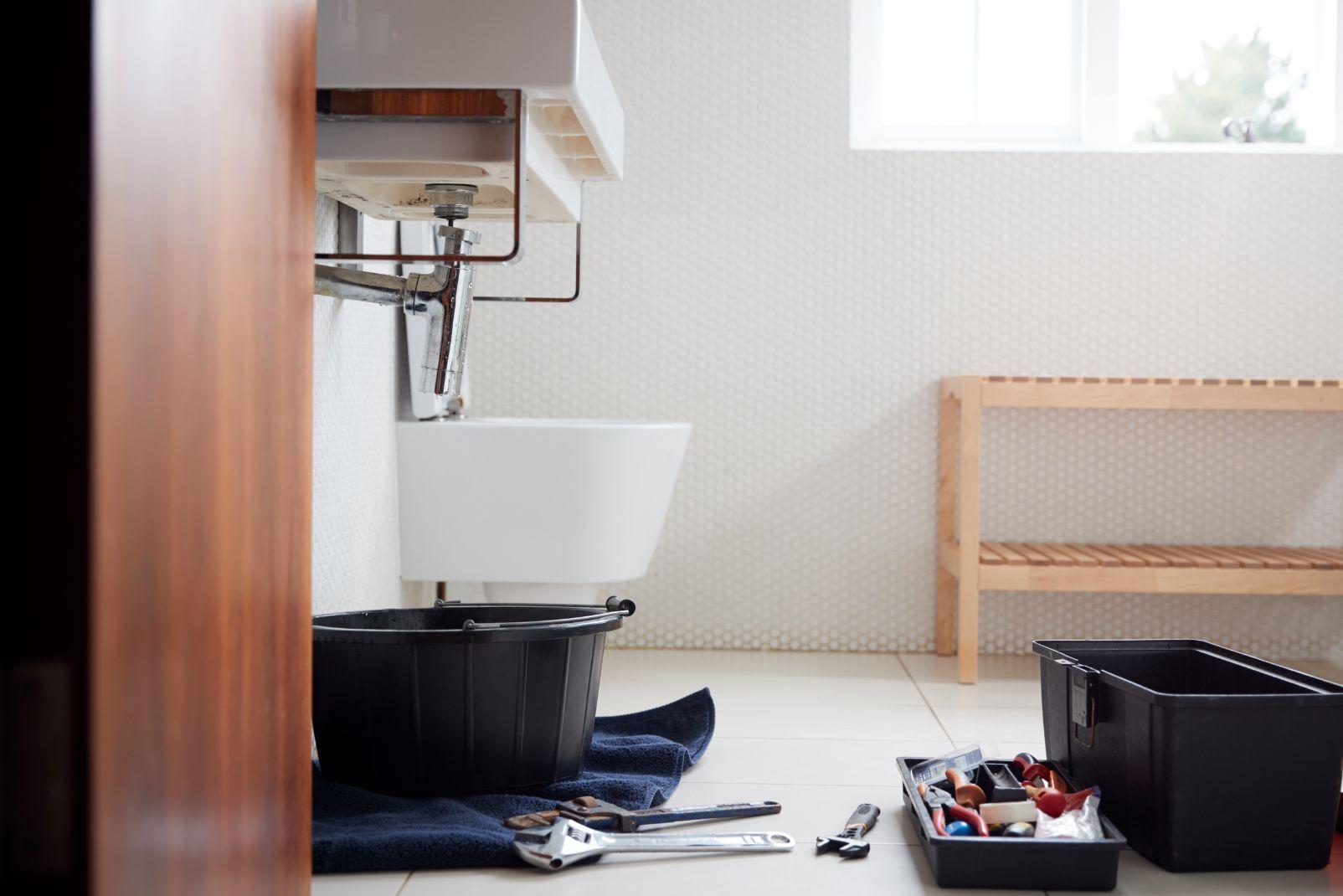 plumbing tools in bathroom ready to repair leaking QXZCX
