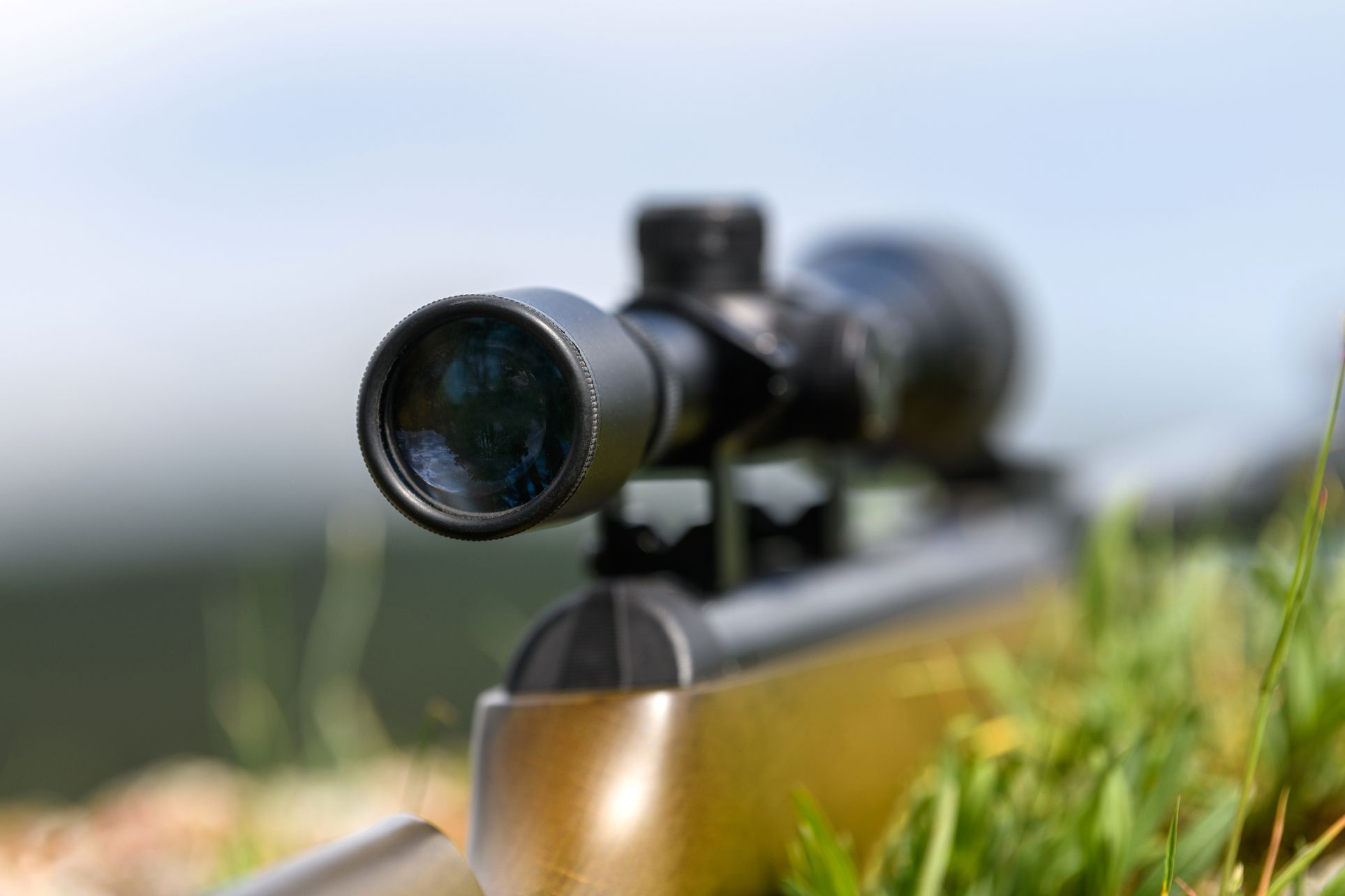 rifle scope on the street with blurry background h STV