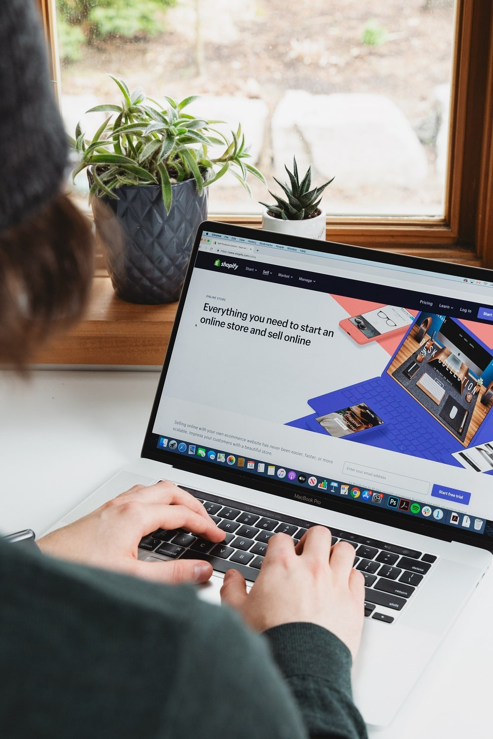 woman creating an ecommerce website with shopify min